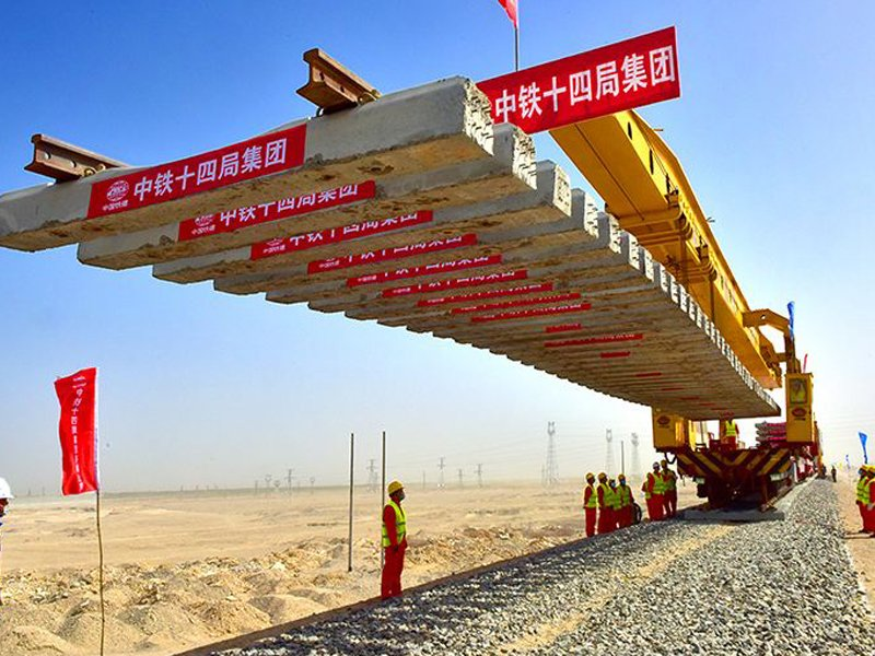 building railway track with track laying machine